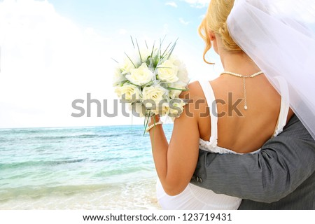 Just married couple looking towards the future - stock photo