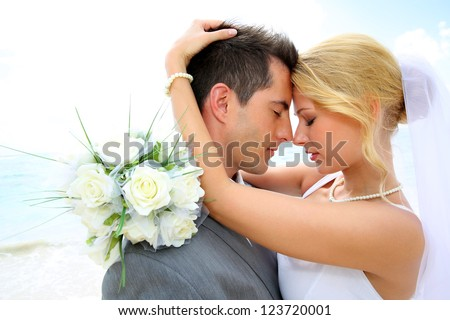 Just married couple sharing romantic moment - stock photo