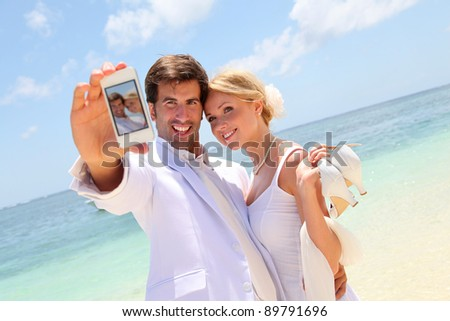 Just married couple taking picture of themselves - stock photo