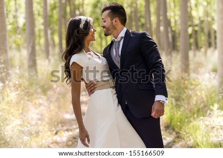Just married couple together in poplar background - stock photo