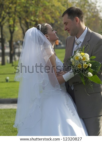 Just married embracing in park outdoors in autumn