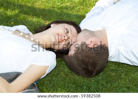 just  married lying on the grass