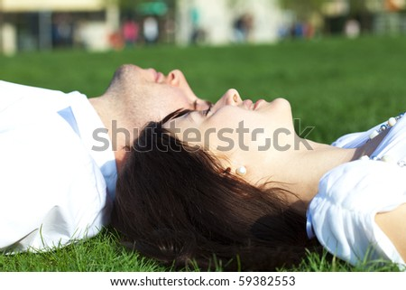 just  married lying on the grass - stock photo
