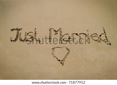 Just married message in beach sand