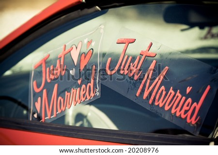 just married sign on a car - stock photo
