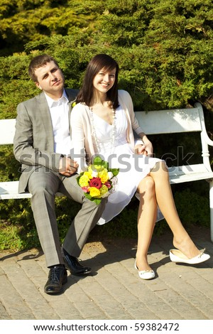 just  married sitting on the bench - stock photo