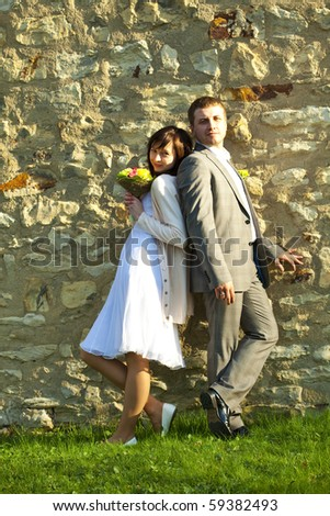 just  married   standing?at wall - stock photo