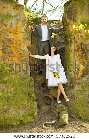 just  married   standing by the stone - stock photo