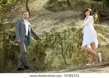 just  married   standing by the stone