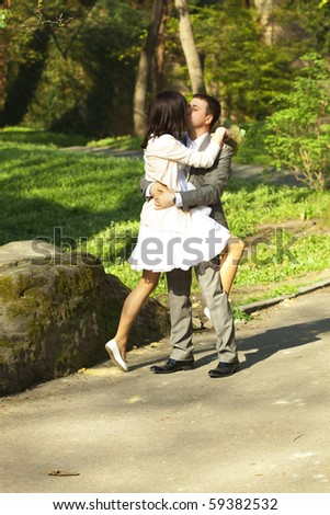 just  married standing on the road - stock photo