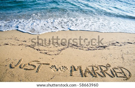 Just Married written in the Sand on the Beach - stock photo
