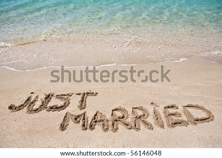Just married written on the sand - stock photo