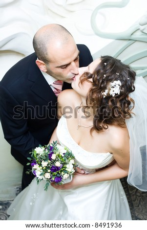 Just married young couple in wedding wear with bridal bouquet. Special toned photo f/x