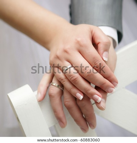 Just married young couple showing up their rings - stock photo