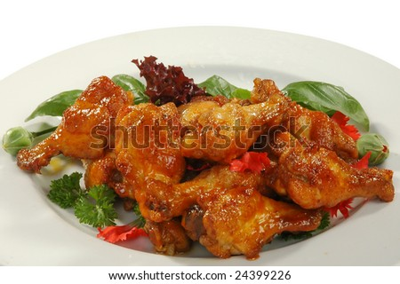just prepared fried chicken legs in friture - stock photo