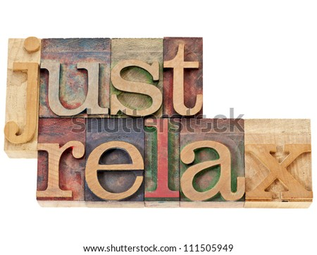just relax  - isolated words in vintage letterpress wood type stained by color inks