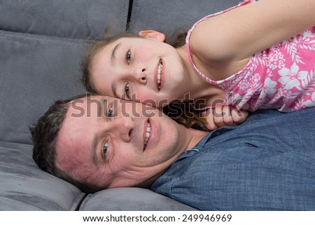 Just relaxing together - father and daughter - stock photo