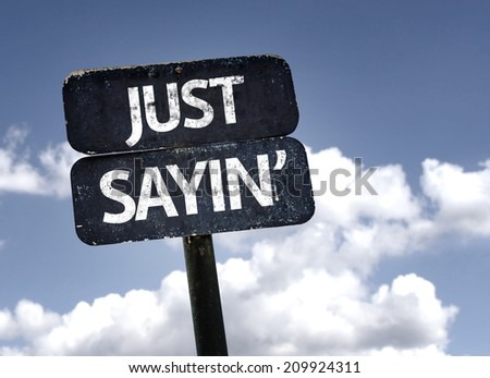 Just Sayin' sign with clouds and sky background  - stock photo