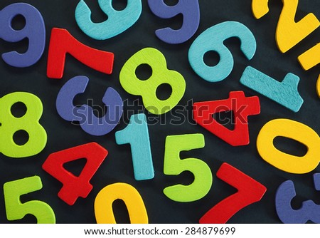 Just various numbers in different colors, colorful background.
