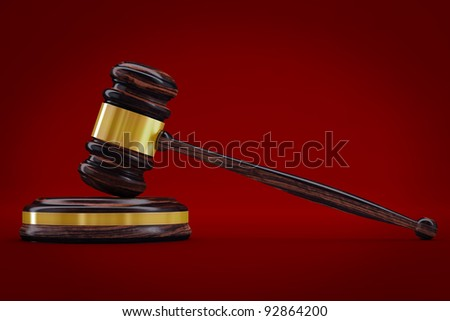 Justice gavel in red background - stock photo