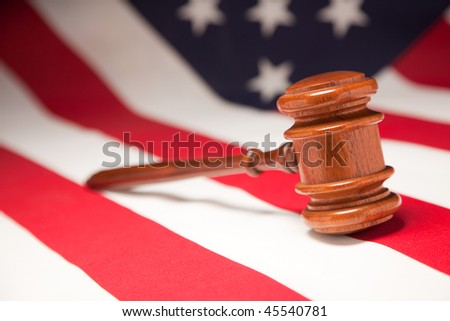 Justice Gavel Resting on an American Flag. - stock photo