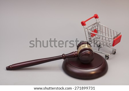 Justice Gavel with Shopping Cart on gray background - stock photo
