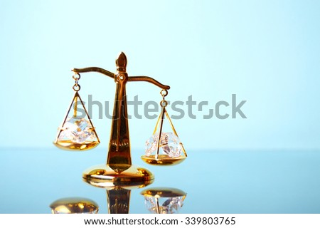 Justice. Gold scales on the mirror surface - stock photo