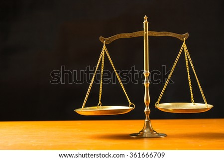 Justice of scale with black background. - stock photo