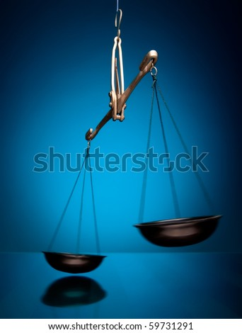 justice scale intentional motion blured isolated on blue background - stock photo