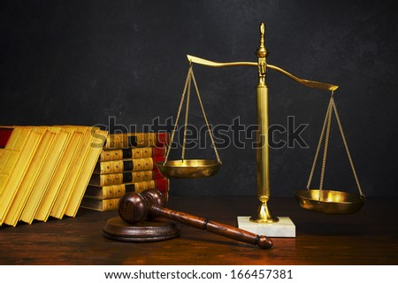 Justice scale with law books - stock photo