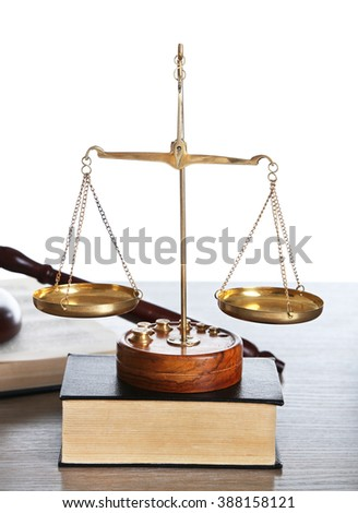Justice scales with wooden gavel and books on white background, close up - stock photo