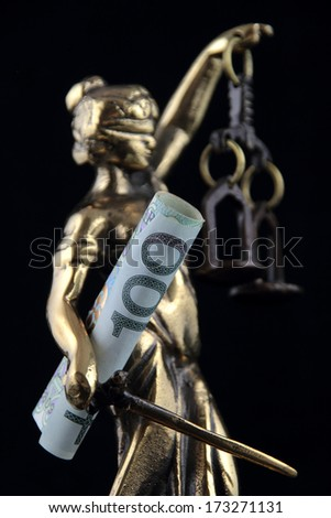 Justice Statue and polish banknote. Lawyer background - stock photo