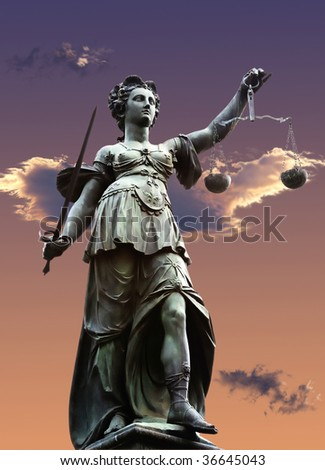 justice statue with sword and scale. cloudy sky in the background. - stock photo