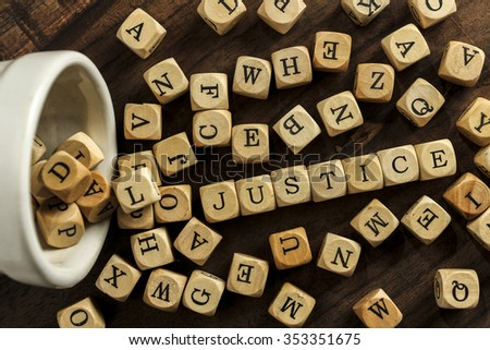 JUSTICE word on wood blocks concept - stock photo
