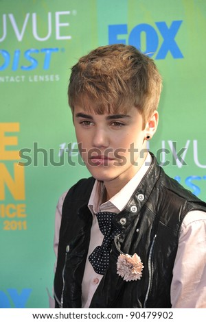 Justin Bieber arrives at the 2011 Teen Choice Awards at the Gibson Amphitheatre, Universal Studios, Hollywood. August 7, 2011  Los Angeles, CA Picture: Paul Smith / Featureflash - stock photo