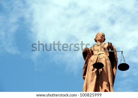 Justitia, the goddess of justice - stock photo