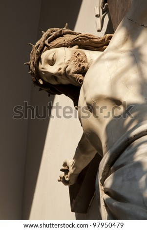 Jusus on the cross from entry of Vienna church - stock photo