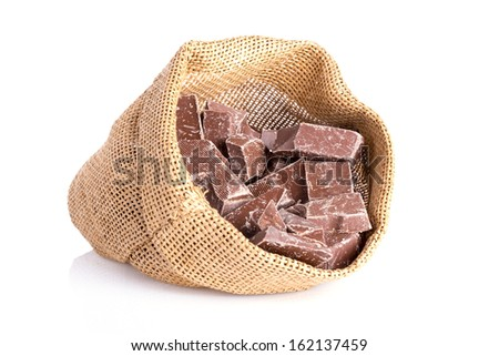Jute bag with pieces of chocolate for Dutch Sinterklaas event - stock photo