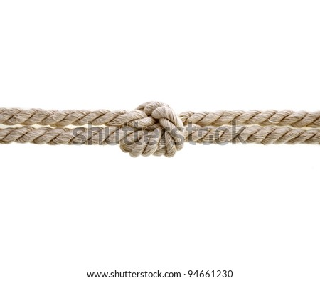 Jute rope with knot on white background - stock photo