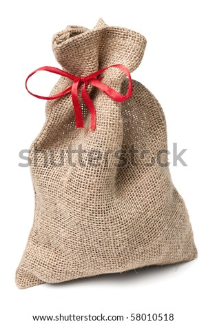 Jute sack present with red ribbon - stock photo