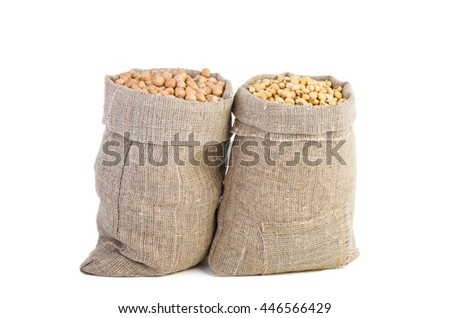 Jute sack with dried peas and soja beans isolated on white background - stock photo