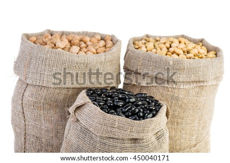 Jute sacks with dried peas, soja beans and black legume isolated on white background - stock photo