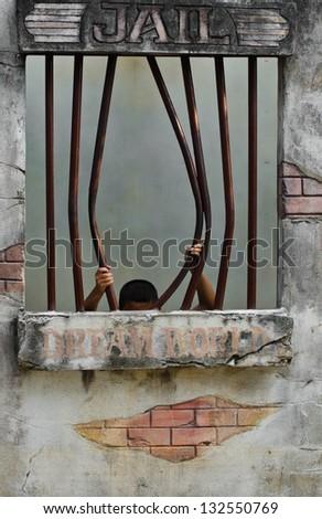 Juvenile delinquent to Prison break. - stock photo
