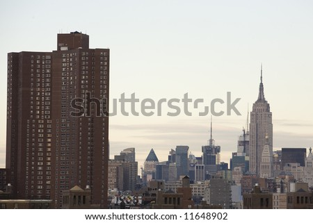 Juxtaposition of a Manhattan housing project with the Empire State Building