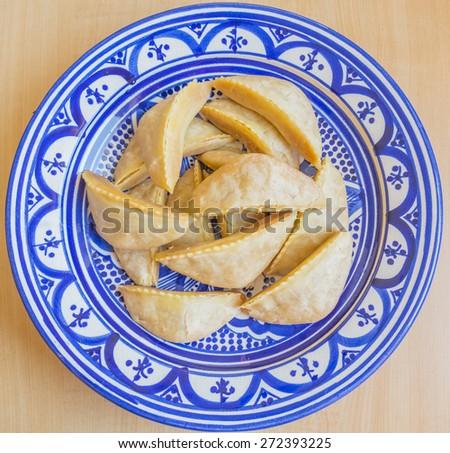 Kaab el Ghazal - Gazelle Horns - Traditional Moroccan cookies - stock photo