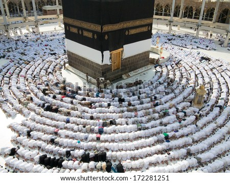 Kaaba the Holy mosque in Mecca with Muslim people pilgrims of Hajj praying in crowd (newest and very rare images of Holiest mosque after latest widening 2013-3014) - stock photo