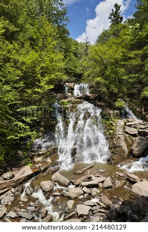 Kaaterskill Falls is a two-drop waterfall in eastern Catskill Mountains, New York, north side of Kaaterskill Clove. The dual cascades total 260 ft (79 m) in height, one of the higher waterfalls in NY - stock photo