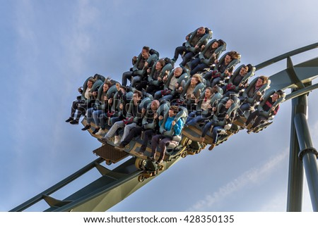 KAATSHEUVEL/THE NETHERLANDS - OCTOBER 31th, 2015: Efteling park ride excited faces of people enyoing a rollercoaster ride in the brand new Baron 1898 of Efteling Theme Park - stock photo