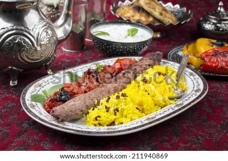 kabab-e-koobideh with sereshk polo - stock photo