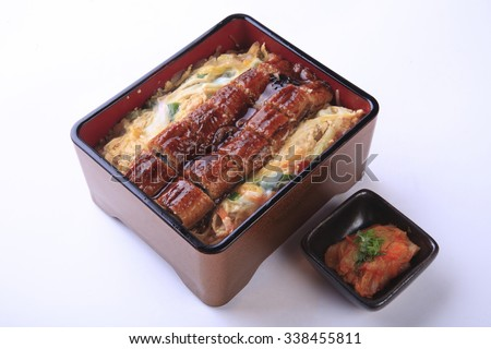 kabayaki in wooden box, Unagi searve as unadon (with rice) isolated on white background.